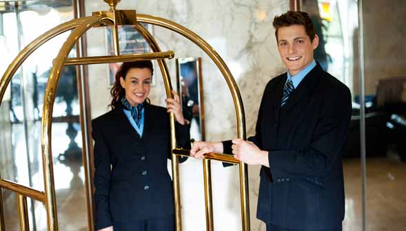 Hotel Summer Bell Staff Smiling for Camera