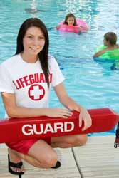 Summer Lifeguard Poses for Photo by Swimming Pool